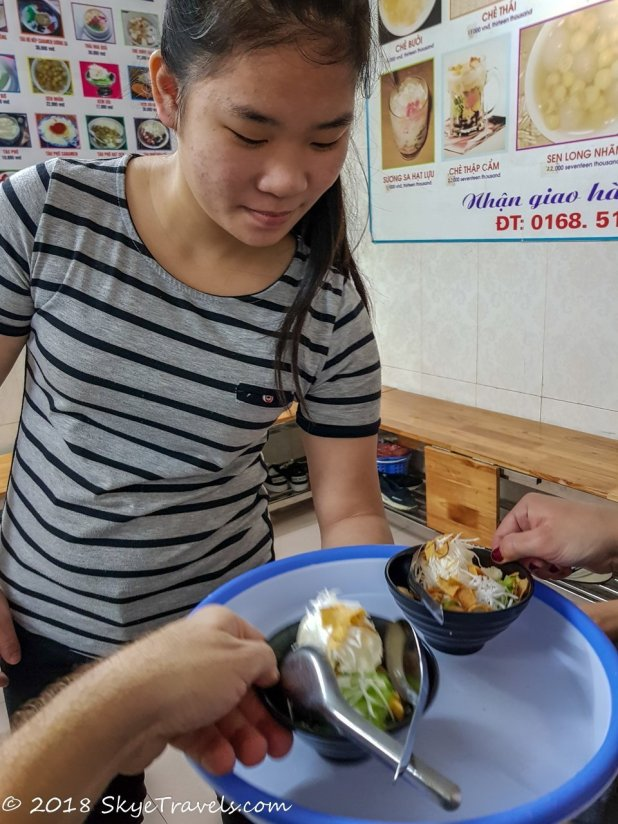 Serving Coconut Ice Cream Desert on Hanoi Food Tour