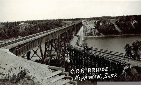 A very old photo of the Old Nipawin Bridge. That's a team of horses crossing it. The upper level is railroad tracks, the lower level is for a single lane of traffic. Click if you want to see a larger version.