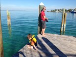 Uncle Ed and Thomas fishing from the pier in Valentine's Marina, Dunmore Town.