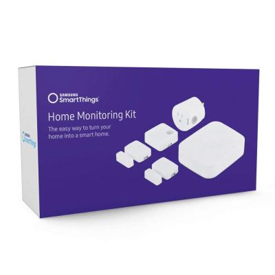 An image of the Samsung SmartThings Home Monitoring Kit box.  The front of the box is purple and shows the white SmartThings devices that are included in the kit.