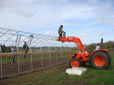 The new tractor is already paying for itself by serving as movable scaffolding.