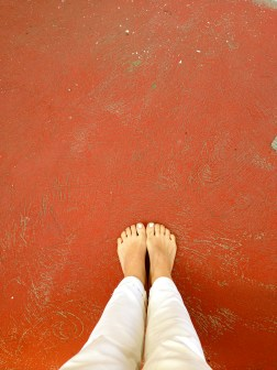 white toes on red floor