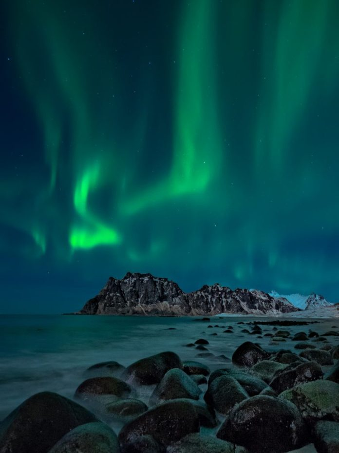 An image of the aurora borealis, or Northern Lights, from Uttakleiv Beach in the Lofoten Islands of Norway, taken by Randall Peterman. | SkyNews