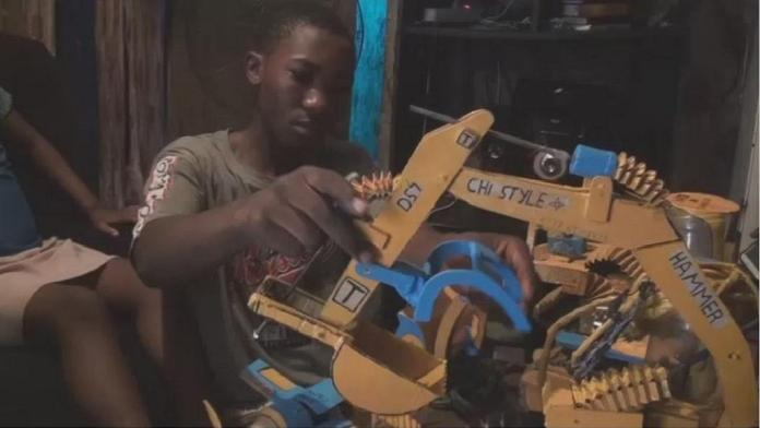 Cameroonian child build bulldozer from recycled materials