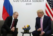 With a smile, Trump tells Putin 'don't meddle in the election'
