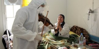 sky news africa Tunisian doctor plays violin to boost virus patients' morale