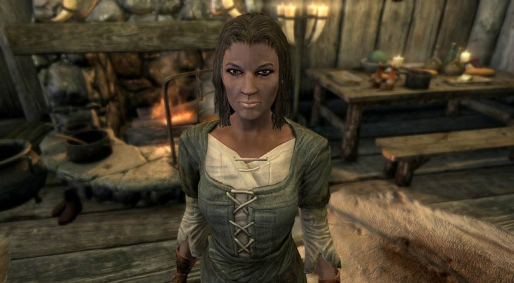 Imperial lumberjack Gilfre standing in her house at Mixwater Mill in Skyrim