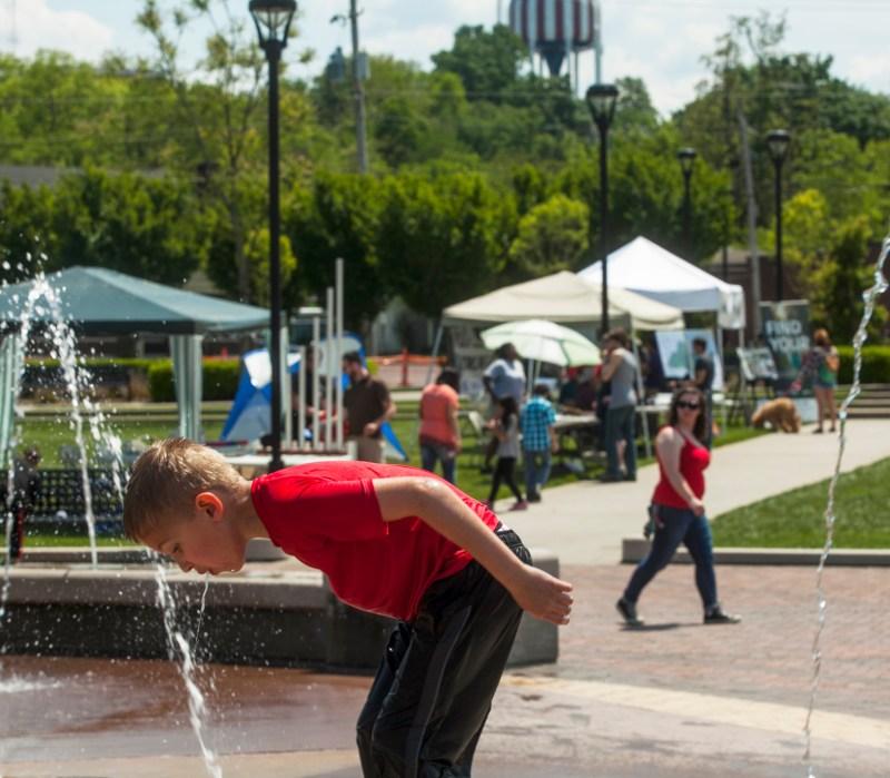 enjoying the Circus Square Park fountain
