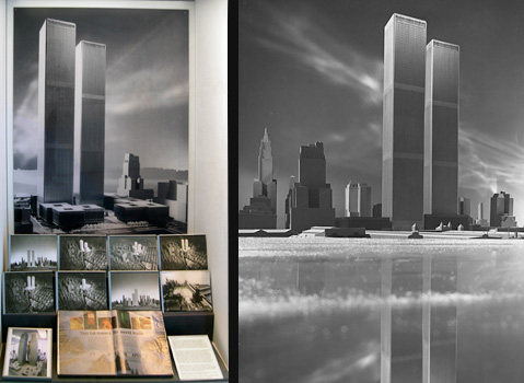 Case view showing a black and white photograph of a scale model of the World Trade Center as seen as from the Hudson River.