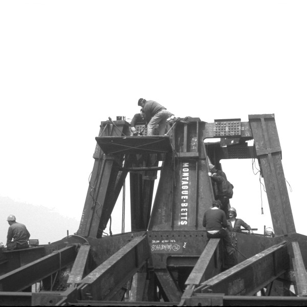 Photograph in black and white of the steel work that will support the antenna of the North Tower