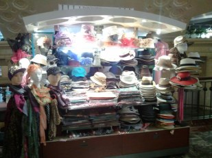 Kiosks of jewelry and hats delight the eye