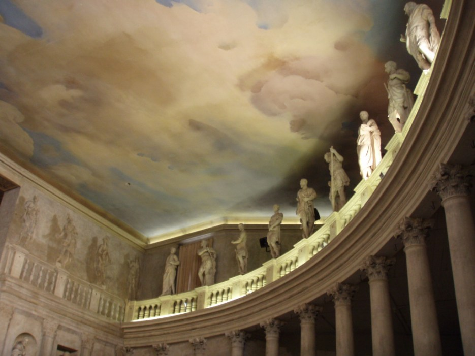 Great clouds of a surreal sky gather above the audience