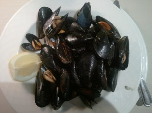 Steamed Mussels. I eat them without the butter they are so tasty.