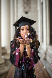 Texas A&M Aggie Senior Blowing Confetti from her hands
