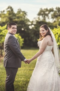 Bride and Groom holding hands at the Bernhardt Winery in Plantersville, Texas