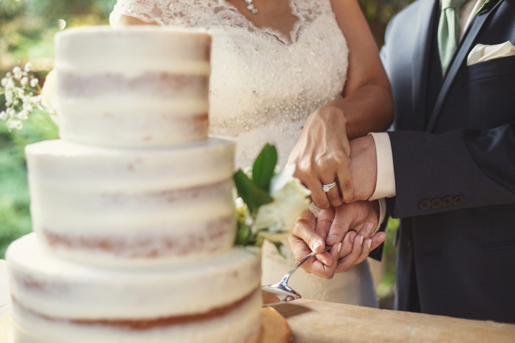 Cutting the cake during the wedding reception at the vine in frisco texas