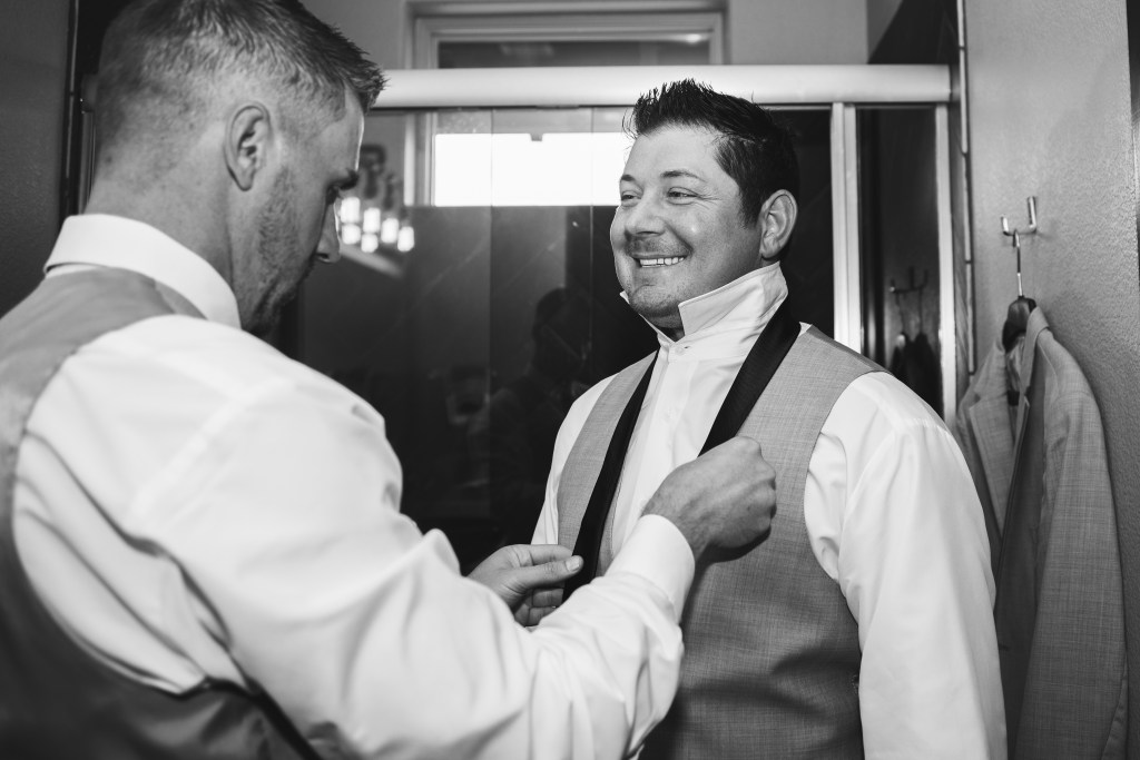 Flower Mound, Texas | Groom tying his tie | Skys the Limit Production | Lewisville Wedding Photographer