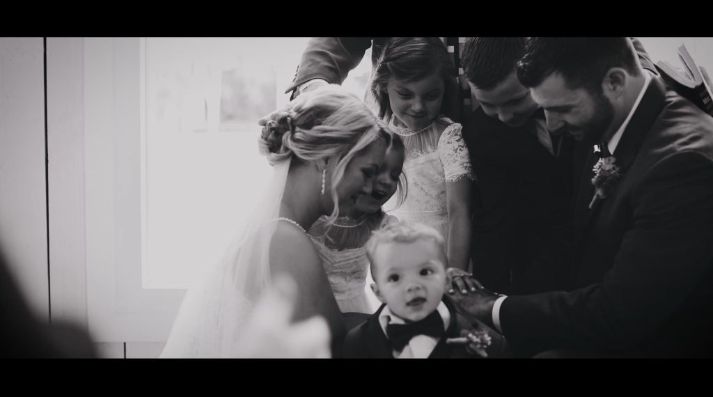 Family prayer during wedding ceremony at the SPRINGS Event venue in Wallisville, Texas | Skys the Limit Production