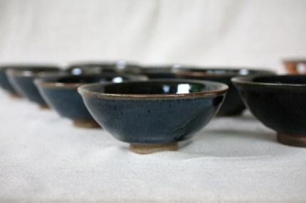 Svend Bayer 35 (sold), 51, 52 (sold), 53 (sold), 54, 55, 56(sold), 57 (sold). Set of 4 exceptional Black Blue kaki glazed with wood ash Bowls still unsold 7 x 15.5 cm £110 each