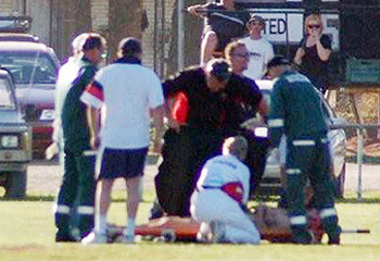 Roberts gets tended to after injurying his foot when attempting a naked cartwheel.
