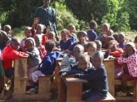 Kindergarten class being taught by their teacher.