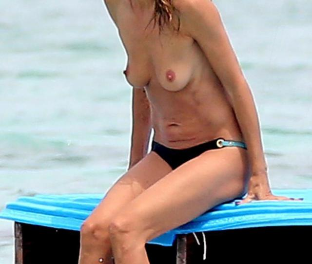 Heidi Klum Topless In Cool Shades At Beach 5