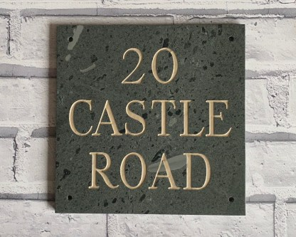 a piece of 20cm square westmorland slate engraved with a house name, painted text and matt sealed