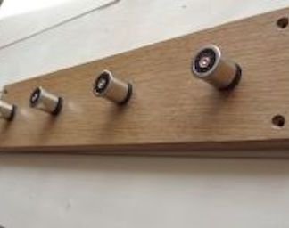 slateandoak solid oak plaque fitted with spent cartridge cases for use as a coat or key rack