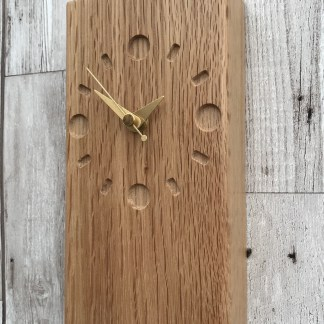 tall slim solid oak block engraved with a clock face