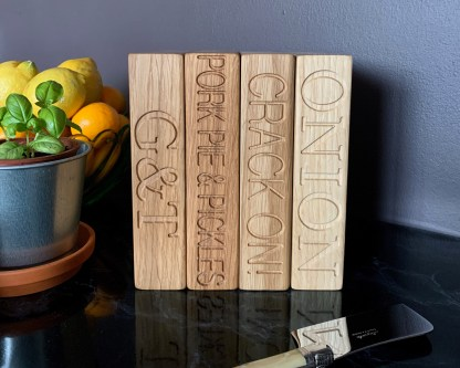 collection of small oak chopping blocks engraved with a different set of text