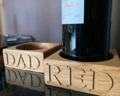 solid oak square block with recess in the middle for a wine bottle, engraved along the front edge