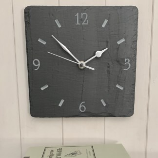 square welsh grey slate clock with an engraved clock face featuring numbers 12 3 6 9
