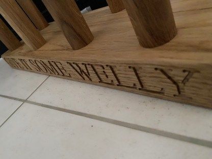 close up of the posts on the solid oak welly rack showing them inset into the wood