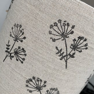natural linen fabric with a hand printed design of a cow parsley