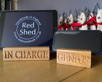 solid oak tablet dock and phone dock with engraved inscriptions on front edge