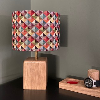 drum style lampshade in a tapestry fabric with a harlequin design