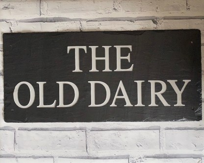 full view of the old dairy house sign made using a piece of hand cut welsh grey slate