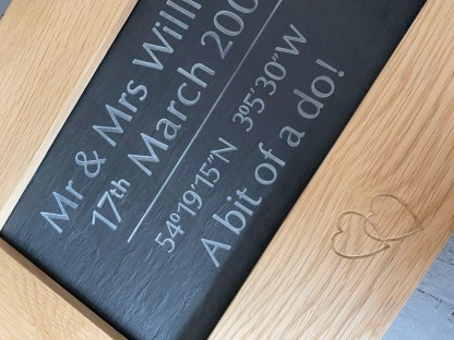 alternative view of the engraved slate framed in solid oak. entwined hearts engraved into the oak frame