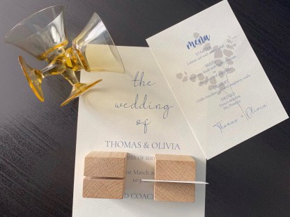 view from the top of the place card holder showing the channel across the top with a name card inserted