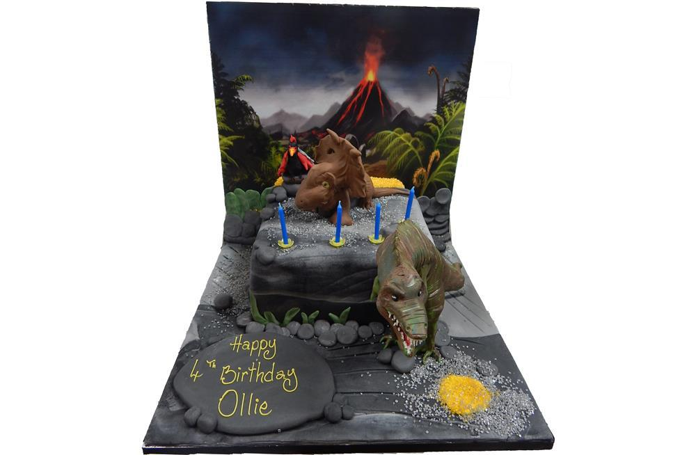 dinosaur cake with backdrop