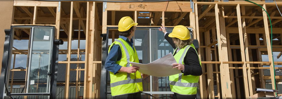 Two Construction Workers Pointing At Structure