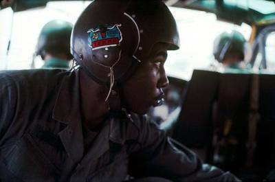 An American Crewman In Helicopter During A Medical Evacuation Flight