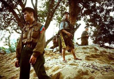 North Vietnamese Officer and His Men in Position During Tet Offensive