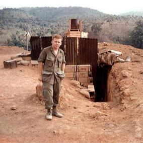 Soldier Stands in Front of His Defensible Hooch