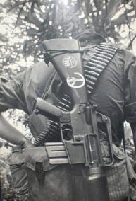 Soldier With Peace Symbol on His Rifle