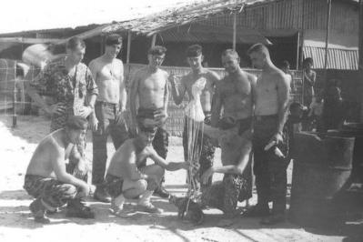 Soldiers With Their Civet Cat And A Mortar Parachute