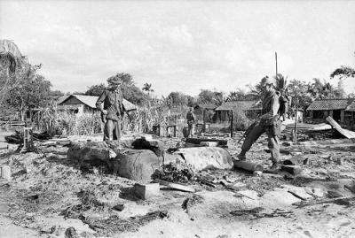 Soldiers from 7RAR Examine Ashes and Rubble of Houses in Long Dien, February 1968