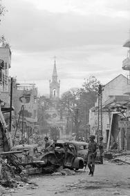 South Vietnamese Soldiers Inspect Destruction of Saigon's Cholon Section