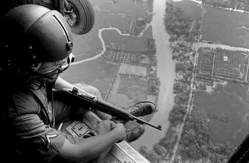 U.S. Helicopter Crewchief Watches Ground Movements of Vietnamese Troops - Remembering The Vietnam War