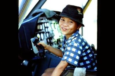 Vietnamese Child Sitting in the Cockpit of a Huey Helicopter